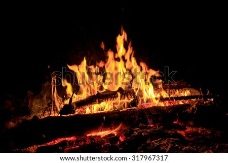 flame of hot fire in dark - abstract photo - stock photo