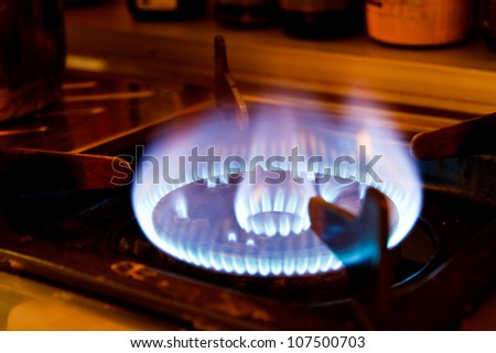 Flame on a gas stove in the kitchen. - stock photo