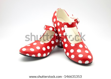 Flamenco dance shoes spotted on white background - stock photo