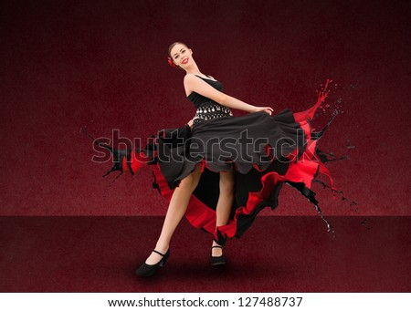 Flamenco dancer with dress turning to paint splatter on deep red background - stock photo