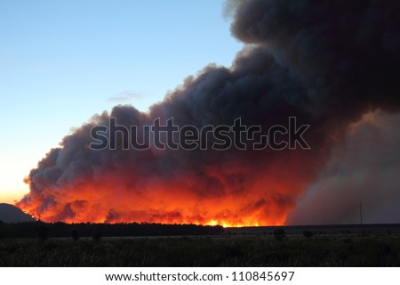 Flames and smoke column Castrocontrigo wildfire, Leon, started August 19, 2012 - stock photo