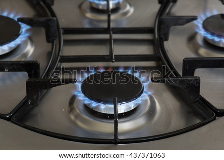 flames burning on a gas stove in the kitchen - stock photo