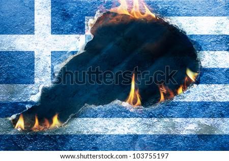 Flames burning through Flag of Greece - stock photo