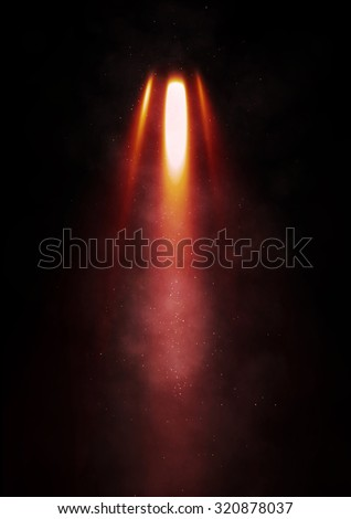 Flames erupt from a rocket - stock photo