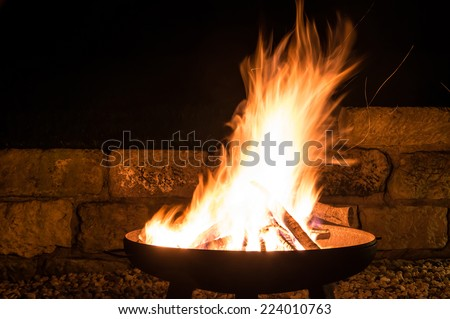 flames in a fire bowl - stock photo