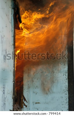 flames rolling - stock photo
