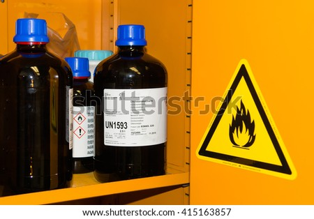 Flammable Chemicals in Protection Cabinet - stock photo