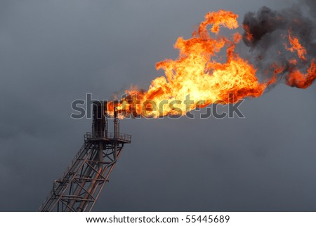 Flare boom nozzle and fire on offshore oil rig, thailand - stock photo