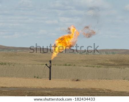 Flaring Natural Gas in North Dakota - stock photo