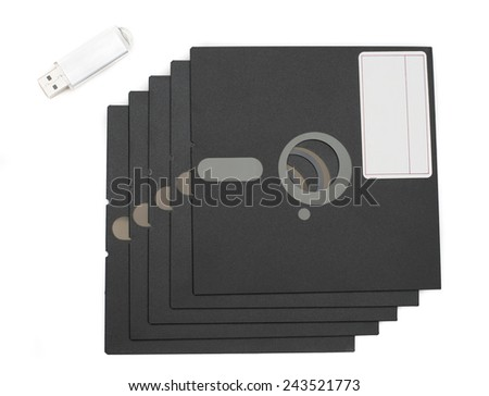 Flash drive and floppy discs - stock photo