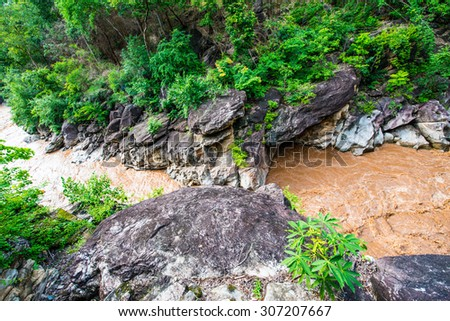 Flash flood flowing in Ob Luang national park, Thailand. - stock photo