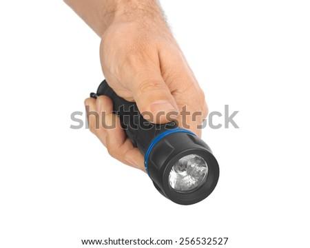 Flashlight in hand isolated on white background - stock photo