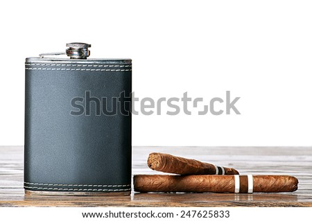 Flask for whiskey and cigars on the table with isolated backgrou - stock photo