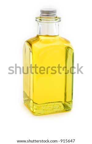 Flask of yellow oil on white background - stock photo