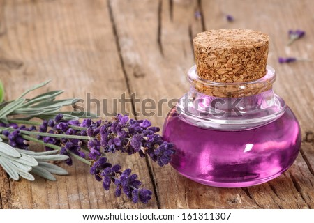 Flask with lavender oil - stock photo