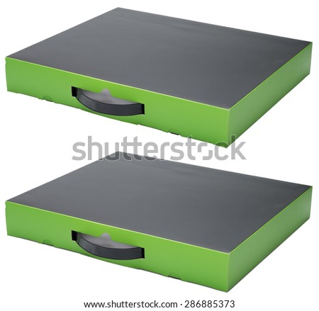 Flat black and green cardboard box with handle isolated on white. With shadow and without. In horizontal situation. - stock photo
