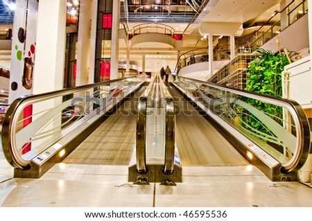 flat empty escalator in the shopping mall - stock photo
