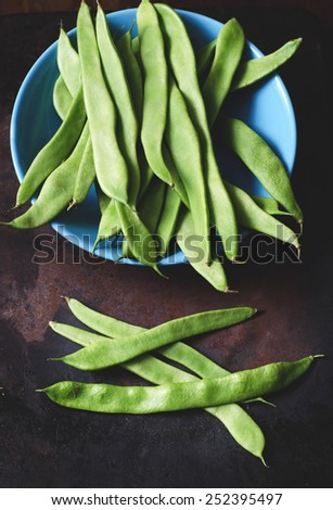 Flat Green Beans on a dark Background - stock photo