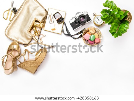 Flat lay for social media fashion bloggers. Feminine accessories, bag, shoes, vintage no name photo camera on white background - stock photo