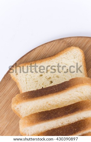 Flat lay image toast bread on the board. - stock photo