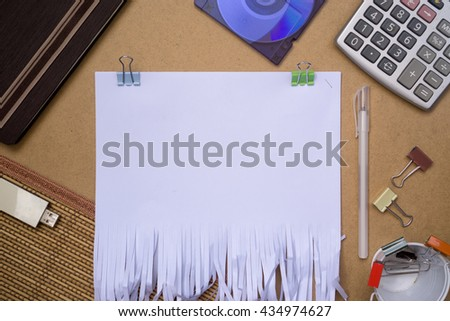 Flat lays image of recycle paper shred of document on brown paper background. with office stationary as prop (empty template) - stock photo