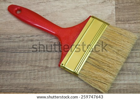 Flat paint brush painting at home - stock photo
