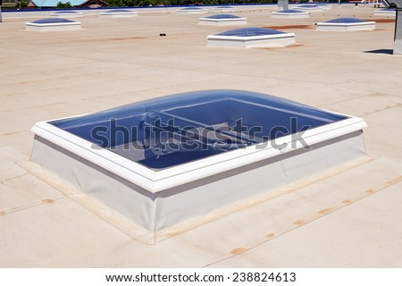 Flat roof with skylight and hydro insulation membranes - stock photo