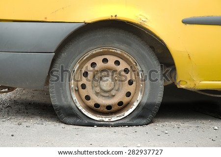 Flat tire of an old car - stock photo