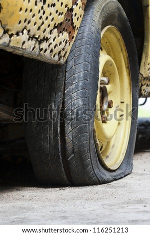 Flat tire of old car - stock photo