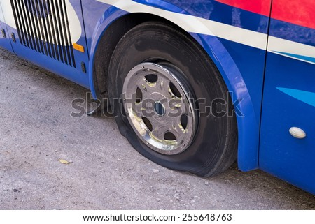 Flat tire on a bus - stock photo