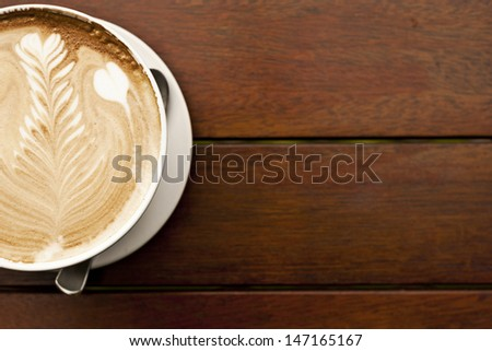 "flat white coffee with latte art, this leaf pattern is commonly called  ""rosetta"" and is the hallmark of a barista's skill at latte art. - stock photo"