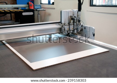 Flatbed cutter/router (cutting plotter). Cutting plotter is used to produce weather-resistant signs, posters, POP, display and billboards. - stock photo