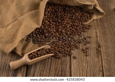 flavor of coffee and wooden background - stock photo