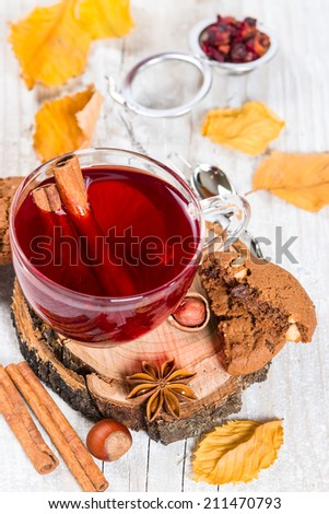 Flavored fruit tea with cinnamon on wooden background, autumn concept - stock photo