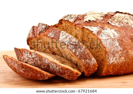 flavored sliced bread on a wooden stand isolated on white - stock photo