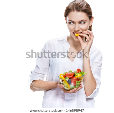 flawless european woman & raw vegetable salad / fantastic girl of the european appearance holds dieting vegetable salad in transparent crockery - isolated on white background  - stock photo