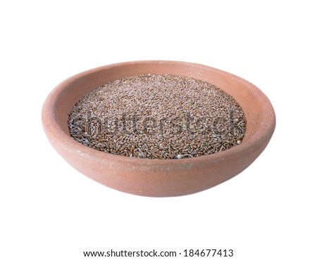 Flax seeds in a clay bowl isolated on white background - stock photo