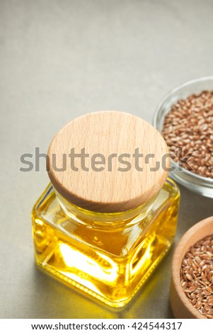 flax seeds in bowl on table background - stock photo