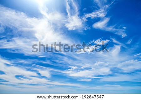 Fleecy clouds in blue sky - stock photo
