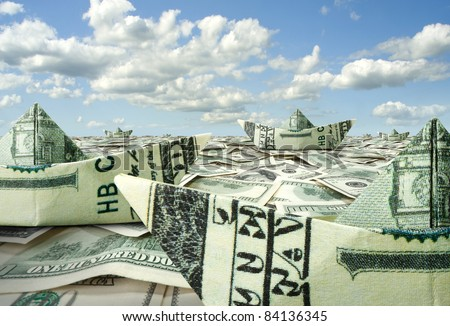 Fleet of dollar boats swimming in financial sea - stock photo