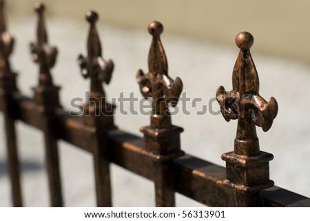 fleur-de-lei fence toppers - stock photo