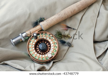 Flies and fly rod ready to go fishing - stock photo
