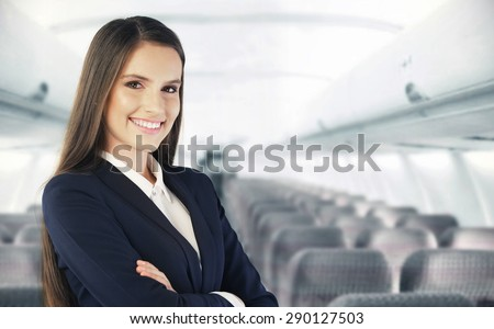 Flight attendant waiting for the passengers to board - stock photo