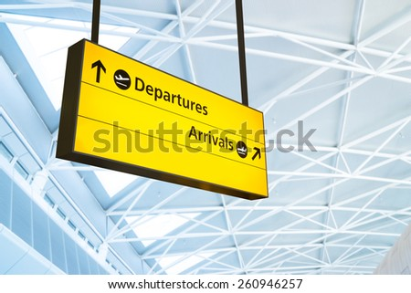 Flight information, arrival and departure board at the airport - stock photo