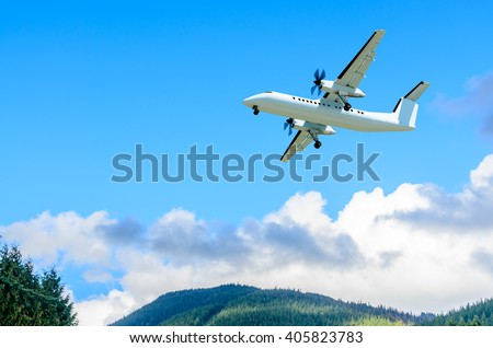 flight of the airplane (jet) over beautiful blue sky with white clouds - stock photo