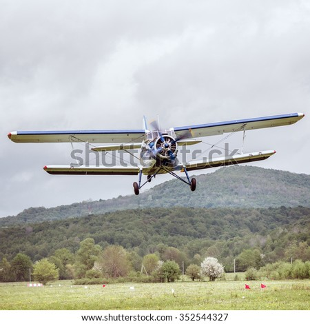 Flight of the old retro plane. - stock photo