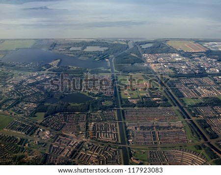 Flight over Almere - Buiten city in Holland. - stock photo