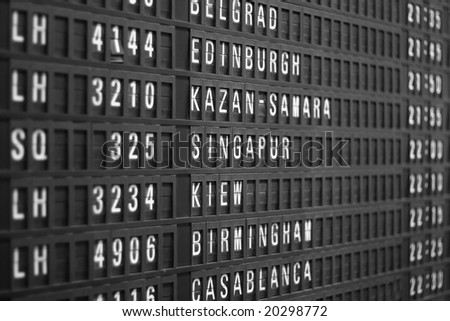 flight schedule display in airport, shallow DOF - stock photo