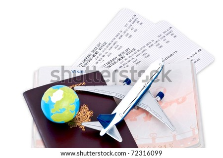 Flight tickets with passports, model of airplane and globe, isolated on white background. - stock photo