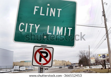 FLINT, MICHIGAN January 23, 2016: Flint City Limit Sign At The Border Of Flint, January 23, 2016, Downtown Flint, Michigan - stock photo